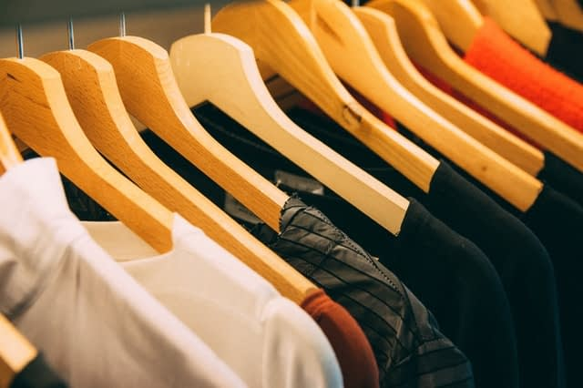 Assorted clothes on hangers